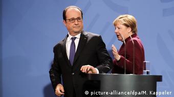 Deutschland | Merkel und Holland - Pressekonferenz nach Normandie-Gesprächen (picture-alliance/dpa/M. Kappeler)