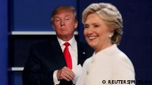 19.10.2016+++Las Vegas, USA Republican U.S. presidential nominee Donald Trump and Democratic U.S. presidential nominee Hillary Clinton finish their third and final 2016 presidential campaign debate at UNLV in Las Vegas, Nevada, U.S., October 19, 2016. REUTERS/Mike Blake TPX IMAGES OF THE DAY