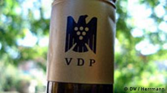 A VDP label around the neck of a wine bottle