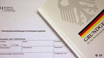 A picture of a portion of the German citizenship test and book on the German constitution