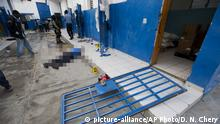 A guard lies dead inside the Civil Prison after a jail break in the coastal town of Arcahaiea (picture-alliance/AP Photo/D. N. Chery)