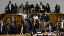 The president of the Venezuelan National Assembly, Henry Ramos Allup (C-up) observes as supporters of Venezuelan President Nicolas Maduro force their way to the National Assembly (Getty Images/AFP/F. Parra)