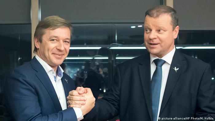 Lithuania's Peasant and Green's Union (LPGU) party leader Salius Skvernelis, right, and Lithuania's Peasant and Green's Union (LPGU) party Chairman Ramunas Karbauskis
