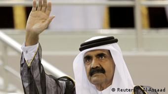 Emir of Qatar Sheikh Hamad bin Khalifa al-Thani waves before the Emir Cup final match between Al-Sadd and Al-Gharafa at Khalifa stadium in Doha (Reuters/F. Al-Assaad)