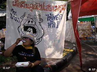 An anti-government protester outside Government House in Bangkok refusing to budge despite the emergency