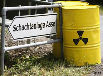 Containers with radioactive material and sign pointing to the Asse salt mine
