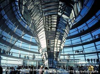 An inside shot of the German parliament building, looking upward