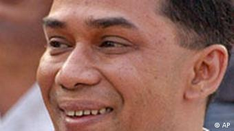 Tarique Rahman, the eldest son of former Prime Minister Khaleda Zia and a senior leader of her Bangladesh Nationalist Party, smiles at a rally in Dhaka, Bangladesh, in October 2006. Bangladesh's army-led security forces arrested Rahman and five other politicians using emergency powers over corruption allegations, media reports said Thursday, March 8, 2007. (AP Photo/Jamil Khan)