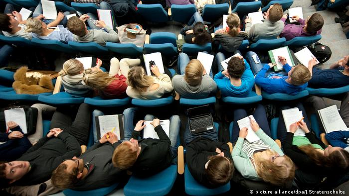 Students sit in a lecture hall