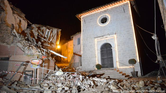 The Church of San Sebastiano stands amidst damaged houses in Castelsantangelo sul Nera, Italy, Wednesday, Oct 26, 2016 following an earthquake