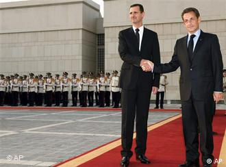 Syrian President Bashar Assad, left, welcomed French President Nicolas Sarkozy at Ash-Shaeb presidential palace, in Damascus Wednesday, Sept. 3, 2008.
