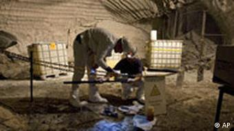 A worker measures for radioactivity in the Asse II 'test' site for atomic waste storage in Germany