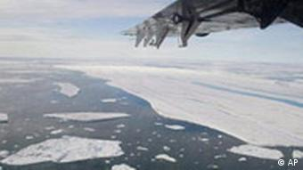 **FILE** In this July 29, 2008 file photo large pieces of ice are seen drifting off after separating from the Ward Hunt Ice Shelf. A chunk of ice shelf nearly the size of Manhattan has broken away from Ellesmere Island in Canada's northern Arctic, another dramatic indication of how warmer temperatures are changing the polar frontier, scientists said Wednesday, Sept. 3, 2008. (AP Photo/Sam Soja, The Canadian Press)