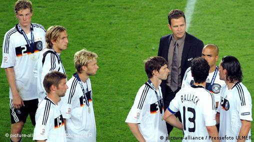 Michael Ballack is restrained by team-mates after the altercation with Bierhoff at the end of the Euro 2008 final