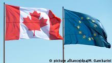27.03.2014*** ARCHIV- Die Flaggen Kanadas (l) und der EuropäischenUnion wehen am 27.03.2014 in Berlin. Der für den 27.10.2016 angesetzte EU-Kanada-Gipfel ist in letzter Minute geplatzt. Foto: Maurizio Gambarini/dpa +++(c) dpa - Bildfunk+++ | Verwendung weltweit