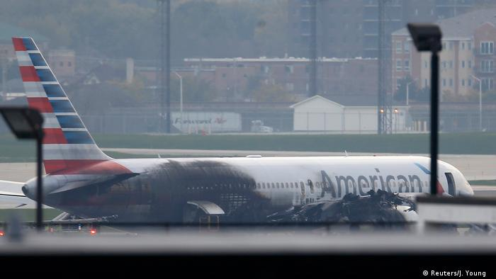 Soot covers the fuselage of an American Airlines jet that blew a tire, sparking a fire (Reuters/J. Young )