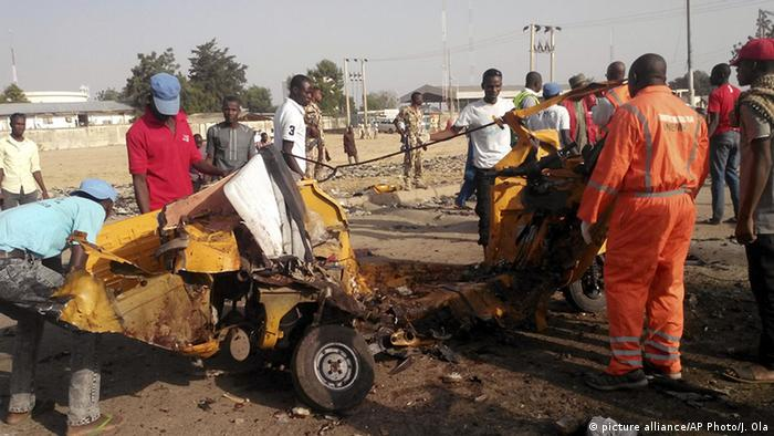 Clearing away debris afer suspected Boko Haram attack