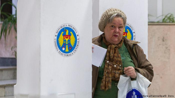 A woman casting her vote in Moldova's elections