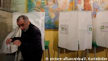 30.10.2016+++ epa05609413 A man casts her ballots at a polling station during the second round of the parliamentary elections, in Tbilisi, Georgia, 30 October 2016. Georgia holds the second round its parliamentary election on 30 October. EPA/ZURAB KURTSIKIDZE +++(c) dpa - Bildfunk+++