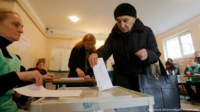Woman casting ballot in Tbilisi