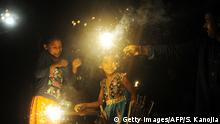 Indian children play with sparklers as they celebrate Diwali