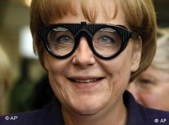 Angela Merkel wearing safety glasses.