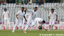 Cricket - Bangladesh v England - Second Test cricket match - Sher-e-Bangla Stadium, Dhaka, Bangladesh - 30/10/16. Bangladesh's Shakib Al Hasan (C) celebrates after taking the wicket of England's Adil Rashid. REUTERS/Mohammad Ponir Hossain