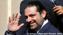 31.10.2016++++ Former Lebanese Prime Minister and lawmaker Saad Hariri waves to journalists upon his arrival to the parliament building to elect a new President, in Beirut, Lebanon, Monday, Oct. 31, 2016. Lebanese security forces tightened security in downtown Beirut on Monday as lawmakers gathered to elect a new president, a vote that's expected to end more than two years of a political vacuum in the country's top post. (AP Photo/Hussein Malla)