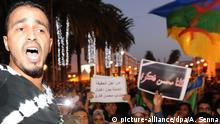 epa05610422 Moroccans angered by the death of the fisherman Mohcine Fikri, crushed to death in a city garbage truck Hoceima, northern Morocco, rally in a protest in Rabat, Morocco, 30 October 2016. Mouhcine Fikri was snapped up by a dumpster while trying to oppose the destruction of his merchandise. EPA/ABDELHAK SENNA +++(c) dpa - Bildfunk+++