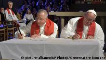 31.10.2016Pope Francis, right, and the President of the Lutheran World Federation Bishop Munib Younan sign a joint declaration during an ecumenical prayer in the Lund Luteran cathedral, Sweden, Monday, Oct. 31, 2016. Francis traveled to secular Sweden on Monday to mark the 500th anniversary of the Protestant Reformation, a remarkably bold gesture given his very own Jesuit religious order was founded to defend the faith against Martin Luther's heretical reforms five centuries ago. (L'Osservatore Romano/Pool Photo via AP) |