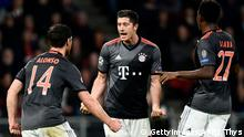 November 1, 2016*** Bayern Munich's Polish forward Robert Lewandowski (C) celebrates with Bayern Munich's Spanish midfielder Xabi Alonso (L) and Bayern Munich's Austrian defender David Alaba after scoring a goal during the UEFA Champions League group D football match between PSV Eindhoven and Bayern Munich at the Philips Stadium in Eindhoven on November 1, 2016. / AFP / JOHN THYS (Photo credit should read JOHN THYS/AFP/Getty Images)
