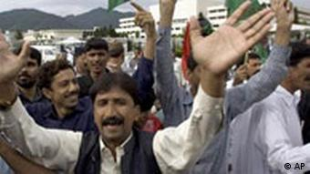 Supporters from the ruling Pakistan People's Party celebrate after unofficial results show their leader Asif Ali Zardari winning in the presidential election at the parliament in Islamabad, Pakistan on Saturday, Sept. 6, 2008. (AP Photo/Anjum Naveed)