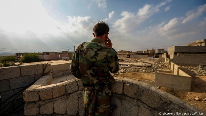 A Peshmerga fighter on the outskirts of Mosul