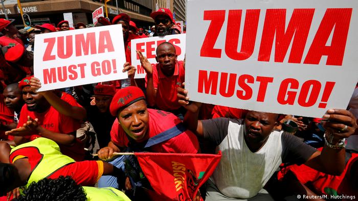 Demonstrators with placards reading Zuma must go! (Reuters/M. Hutchings)