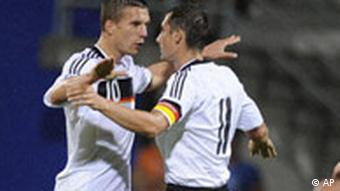 Germany's Lukas Podolski, left, and Miroslav Klose celebrate the opening goal during the World Cup group 4 qualifying soccer match between Liechtenstein and Germany in Vaduz, Liechtenstein, on Saturday, Sept. 6, 2008.