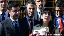Co-leader of the pro-Kurdish Peoples' Democratic Party (HDP) Selahattin Demirtas and Chairwoman Figen Yüksekdag talk to journalists during a press conference after the vote outside Assembly in Ankara, Turkey, on May 20, 2016. Turkish Parliament voting of an article of constitutional change, that could see pro-Kurdish and other lawmakers prosecuted. Assembly adopted a highly controversial bill that would lift immunity for dozens of pro-Kurdish and other MPs and could see them evicted from parliament, sparking fresh domestic and international concern. The bill was backed by 376 MPs in the 550-seat legislature, meaning it will become law directly without being put to a referendum. Only 140 voted against the measure. Under current law, Turkish lawmakers have the right to full immunity from prosecution. The removal of parliamentary immunity has a precedent in Turkey. Back in March 1994, the immunities of four deputies of the now-defunct pro-Kurdish Democratic Labor Party (DEP) – a predecessor of the HDP – were lifted on charges of helping the outlawed Kurdistan Workers' Party (PKK). Previously, current HDP deputy Leyla Zana, Hatip Dicle, Selim Sadak and late Orhan Doğan were elected for the now-dissolved Social Democratic Populist Party (SHP) before splitting off to form the DEP. They were all dragged out of parliament to serve long jail sentences after their immunities were revoked. Photo by Depo Photos/ABACAPRESS.COM  