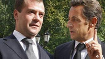 Russian President dmitry Medvedev, left, listens to French President Nicolas Sarkozy, at the presidential residence, outside Moscow, Monday, Sept. 8, 2008.