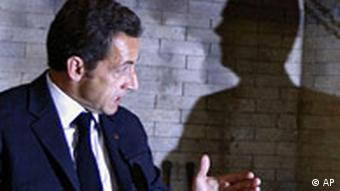 French President Nicolas Sarkozy speaks with Russian President Dmitry Medvedev, whose shadow is seen at right, in the presidential residence outside Moscow on Monday, Sept. 8, 2008.