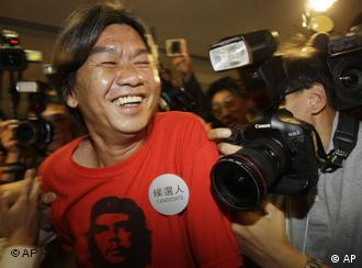 Long Hair Leong Kwok-hung celebrates after being re-elected to Hong Kong's Legislative Council on Sunday
