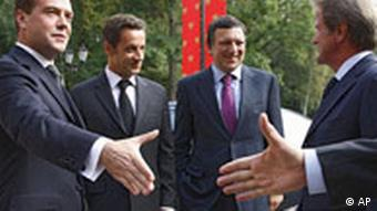 Russian President Dmitry Medvedev, French President Nicolas Sarkozy, European Commission President Jose Manuel Barroso and French Foreign Minister Bernard Kouchner, from left, meet in Medvedev's residence outside Moscow on Monday, Sept. 8, 2008.