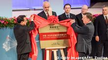 05.11.2016 +++ Chinese Prime Minister Li Keqiang (L) and Latvian Prime Minister Maris Kucinskis (R) unveil a sign of the SINO-CEEF Holding Company after the Summit Meeting of Heads of Government Central and Eastern European Countries and China in Riga, on November 5, 2016. / AFP / Ilmars Znotins / Ilmars ZNOTINS (Photo credit should read ILMARS ZNOTINS/AFP/Getty Images)
