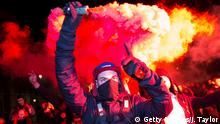 LONDON, ENGLAND - NOVEMBER 05: A masked protester holds up a flare on Whitehall during the Million Mask March on November 5, 2016 in London, England. Thousands of demonstrators, many wearing the Guy Fawkes mask associated with the Anonymous hacking collective, take part in the annual Million Mask March through the streets of central London today. The anti-establishment demonstration, which falls on Guy Fawkes Night, is one of several taking place in cities around the world. (Photo by Jack Taylor/Getty Images)