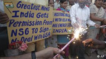 People celebrate the US-India nuclear deal in Ahmedabad, India