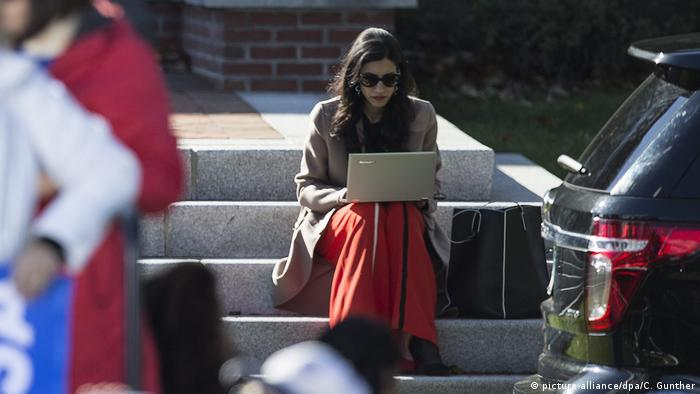 Vice Chairwoman of the Campaign for Democratic Candidate for US President Hillary Clinton, Huma Abedin works on her laptop during a campaign rally.