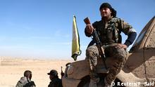 November 7, 2016. A Syrian Democratic Forces (SDF) fighter rests with his weapon on a vehicle camouflaged with mud, north of Raqqa city, Syria November 7, 2016. REUTERS/Rodi Said