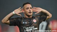 BERLIN, GERMANY - OCTOBER 28: Deniz Naki of St. Pauli celebrsates scoring his goal during the Second Bundesliga match between 1. FC Union Berlin and FC St. Pauli at Stadion An der Alten Foersterei on October 28, 2011 in Berlin, Germany. (Photo by Stuart Franklin/Bongarts/Getty Images)