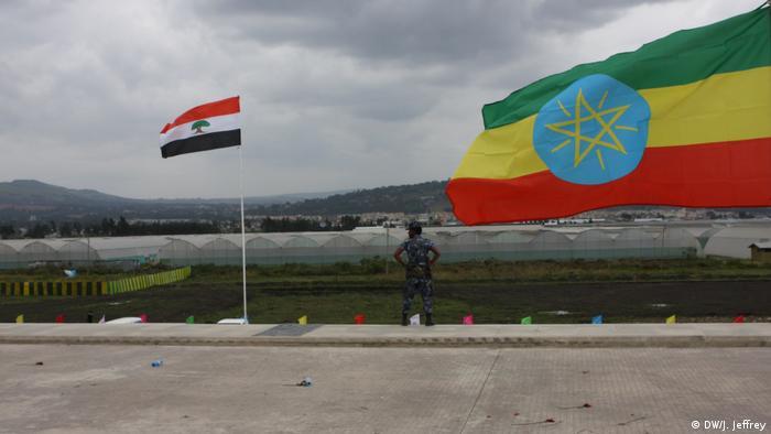 Ethiopia's national flag beside the Oromo regional flag