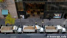 08.11.2016+++ A cyclist rides by a row of sanitation trucks filled with sand acting as barricades along Fifth Avenue outside Republican presidential nominee Donald Trump's Trump Tower in Manhattan, New York, U.S., November 8, 2016. REUTERS/Andrew Kelly