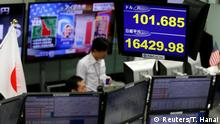 09.11.2016 *** Monitors displaying the Japanese yen's exchange rate against the U.S. dollar (R top) and Japan's Nikkei average and U.S. presidential election news are seen at a foreign exchange trading company in Tokyo, Japan, November 9, 2016. REUTERS/Toru Hanai