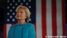 06.11.2016 *** U.S. Democratic presidential nominee Hillary Clinton listens as she is introduced by Gold Star father Khizr Khan at a campaign rally in Manchester, New Hampshire, U.S. November 6, 2016. REUTERS/Brian Snyder